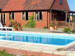 THE MILKING BARN, character holiday cottage, with pool in Diddlebury, Ref 1986