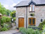 SMITHY COTTAGE, pet friendly, character holiday cottage, with a garden in Graigfechan, Ref 3556