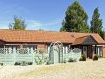 STABLE COTTAGE, pet friendly, character holiday cottage, with a garden in Necton, Ref 3505