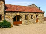 DAIRY COTTAGE, romantic, character holiday cottage, with open fire in Staintondale, Ref 4601