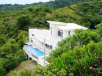 Oceanview architectural masterpiece above Playa Hermosa, infinity pool, WiFi