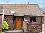 THE BYRE, romantic, character holiday cottage, with a garden in Leighton, Ref 8401