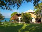 Elegant British Colonial estate, Lime Acre boasts a private beach, pool & full staff