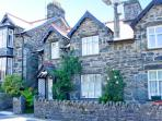 ARTRO VIEW stone cottage, three bedrooms, Spa bath, woodburning stove, enclosed patio, in Llanbedr, Ref 10574
