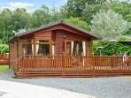 LANGDALE LODGE 15, on site swimming pool, shore of Lake Windermere, deck with furniture on White Cross Bay Ref 18071