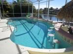 Villa Sunday Rose - 4b/3ba SW Cape Coral Home, electric heated pool with Tiki Hut, Boat Dock with Lift