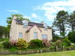 RIVERSIDE, detached, open fire, off road parking, front garden, in Glengarriff, Ref 25779