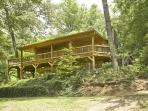 MISTY LAKE LODGE*4BR~3BA~CABIN SITTING ON 10 SECLUDED ACRES WITH A PRIVATE LAKE~WiFi~WOODBURNING FIREPLACE~CHARCOAL GRILL~SAT TV~KING BED IN MASTER WITH FRENCH DOORS OPENING UP TO A PRIVATE HOT TUB~$165/NIGHT!