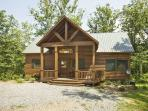 RUNABOUT TROUT LODGE*3BR~2.5BTH~CABIN ON THE TOCCOA RIVER~EXCELLENT TROUT FISHING~TUBING~KAYAKING~SAT TV~INDOOR/OUTDOOR WOOD BURNING FIREPLACES~HOT TUB~JETTED TUB~POOL TABLE~AIR HOCKEY~PAVILION WITH CHARCOAL GRILL AND PICNIC TABLE~PET FRIENDLY~$195/NIGHT!