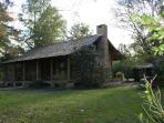 1885 log cabin and modern cabin B&B in Hattiesburg