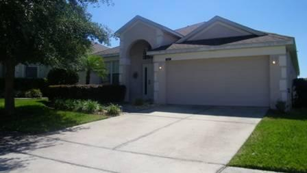 Premier golf community 4 bedroom home with west facing pool! HCD407 - Image 1 - Davenport - rentals