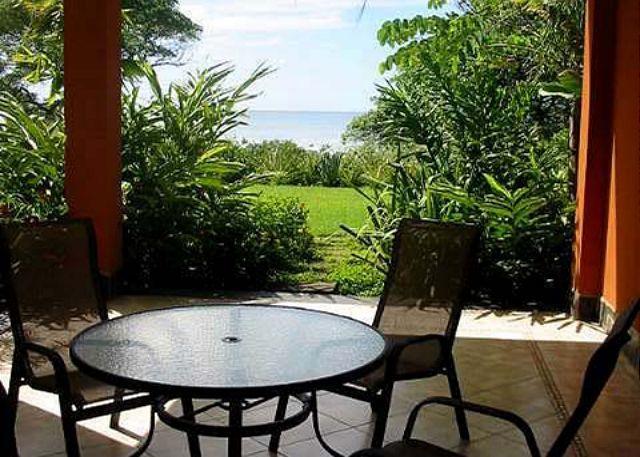 Patio - Luxury beachfront condo- shared pool, custom kitchen, patio, central a/c - Tamarindo - rentals