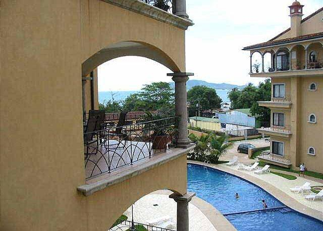 View from balcony - Great hacienda style condo- a/c, pool, across the street from the beach - Tamarindo - rentals