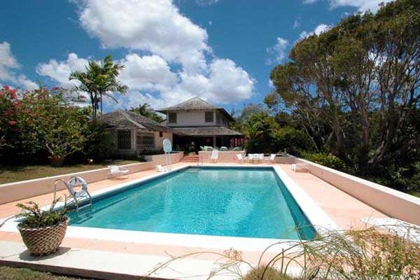 Nestled in two acres of gardens with mature trees and views of the Caribbean sea, this villa begs you to relax.  	 RL INS - Image 1 - Barbados - rentals