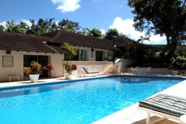 This villa, surrounded by stalwart mahogany trees inside a beautifully landscaped garden, is strategically located 1.25 miles from any disturbances. RL SOL - Image 1 - Barbados - rentals