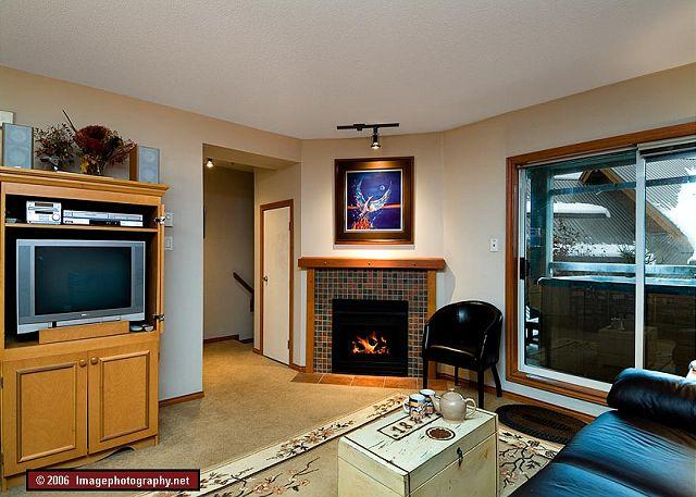 Living room with a private hot tub on the deck - 61 Glaciers Reach this 2br home has a hot tub & pool in Whistler Village - Whistler - rentals