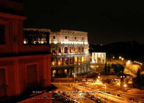 Nighttime view from the Magnifico Apartment terrace. - Perfect Terrace, Dramatic Coliseum View- Magnifico - Rome - rentals