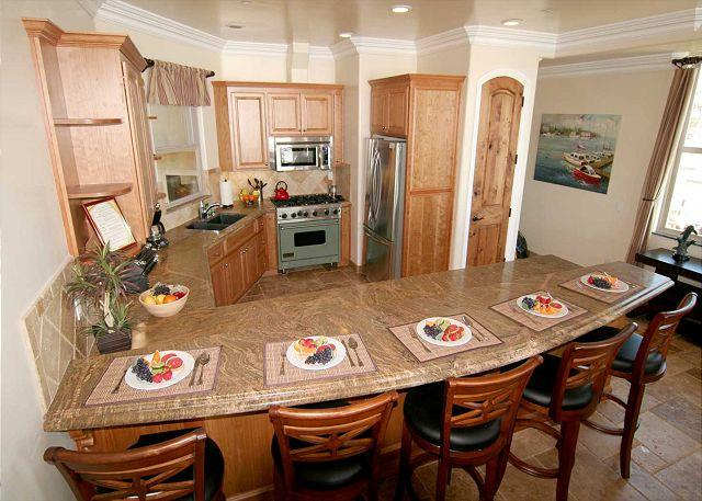 Kitchen with granite counters, viking stove, stainless appliances - Oceanfront unit with 8br/5.5ba, rooftop decks, private spa, A/C Equipped - Oceanside - rentals
