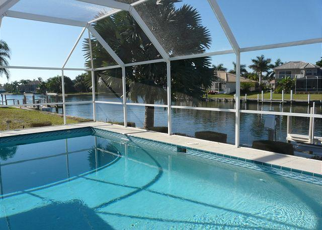 Stylish waterfront home w/ all-day sun & short walk to shopping & dining - Image 1 - Marco Island - rentals