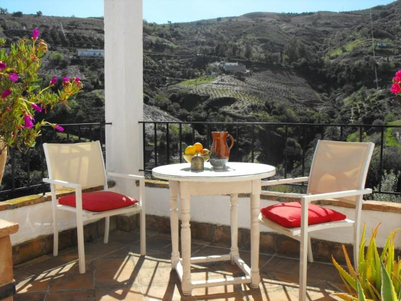 The sunny terrace with views over the valley - Romantic cottage with great views and  free WiFi - Cutar - rentals