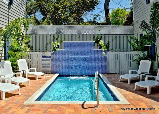 Pool Area Complete With Loungers and a Waterfall - PARADISE SUITE - Monthly Villa In Gated Complex w/ Pool. Steps to Duval St - Key West - rentals