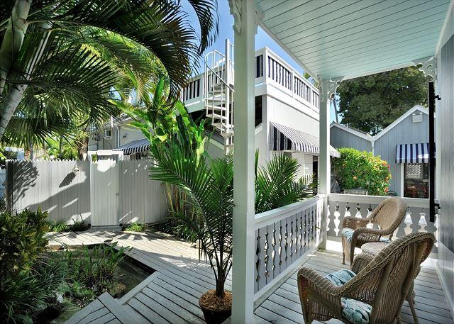 Community Courtyard and Unit's Furnished Front Porch - Family House - Stunning 'Old Town' Home - 1 Block To Duval - Private Hot Tub - Key West - rentals
