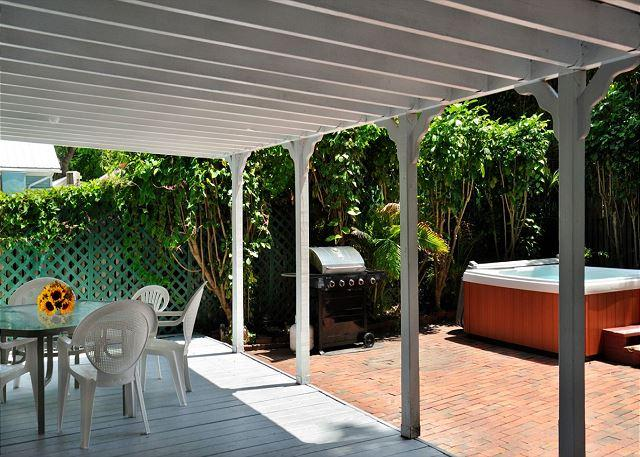 Deck Area With Outdoor Furniture, Jacuzzi, and Grill - Hemingway's View- Great Location, 3 BR 2 Bath, Decked Viranda and Hot Tub - Key West - rentals