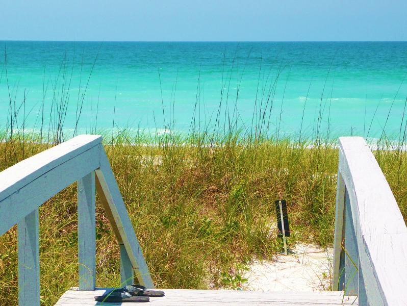 Step across our dune walkway to warm azure blue gulf waters. Swim, snorkel, fish, or just float. - Summer Couples Deals Gulf Beach Front/View 2 Pools Spa  8 HarTru Tennis Cts Gym - Longboat Key - rentals