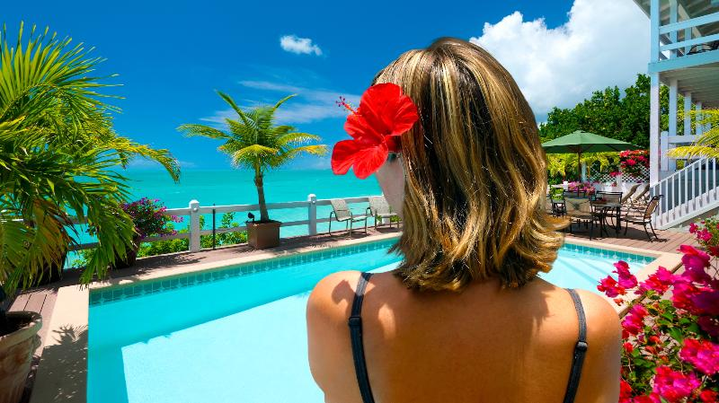 Pool deck overlooking turquoise ocean - Sunset Point Oceanfront Villa - 30% off Apr 4 - 17 - Providenciales - rentals
