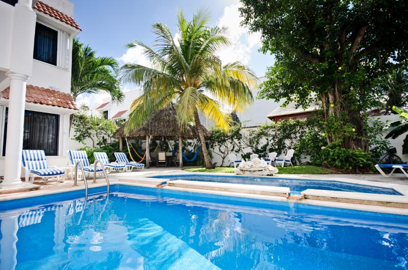 Looking across the pool to the lounge chairs and palapa covered patio - Casa Tomas-2 level-pool. No booking or service fee - Cozumel - rentals