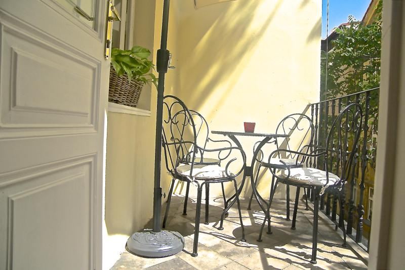 Enjoy breakfast on this sunny balcony with umbrella for shade. - Character, Style, Apt with Balcony in OLD TOWN - Prague - rentals