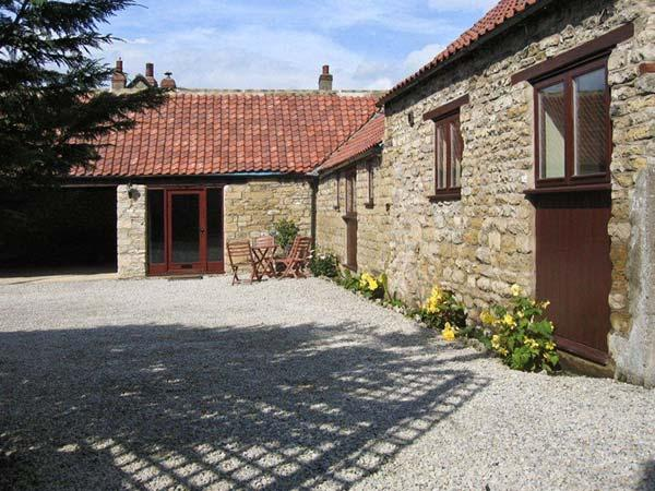 THE OLD COACH HOUSE, family friendly, character holiday cottage, with a garden in Thornton-Le-Dale, Ref 1754 - Image 1 - North Yorkshire - rentals