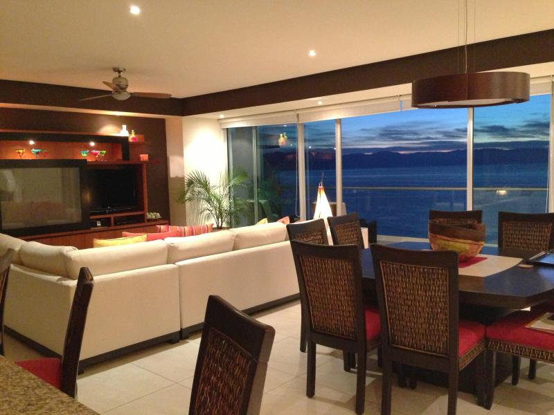 "LIVING/DINING AREA WITH VIEW OF THE OCEAN - LUXURY AT IT'S BEST- PENINSULA   ""SPECIAL OFFER"" - Puerto Vallarta - rentals"