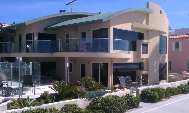 The property is on the ground floor with the Private Oceanfront patio - 14ft wide Oceanfront Window to waves Luxury Condo - Pacific Beach - rentals
