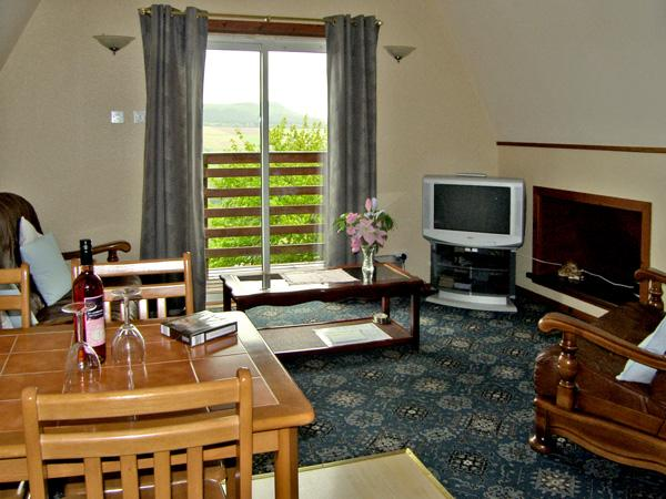 LARCHFIELD CHALET 1, pet friendly, country holiday cottage, with a garden in Strathpeffer, Ref 3557 - Image 1 - Strathpeffer - rentals