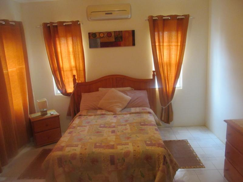 Cozy Bedroom - Nature Gardens Vacation Apts Near Rendezvous Beach - The Valley - rentals