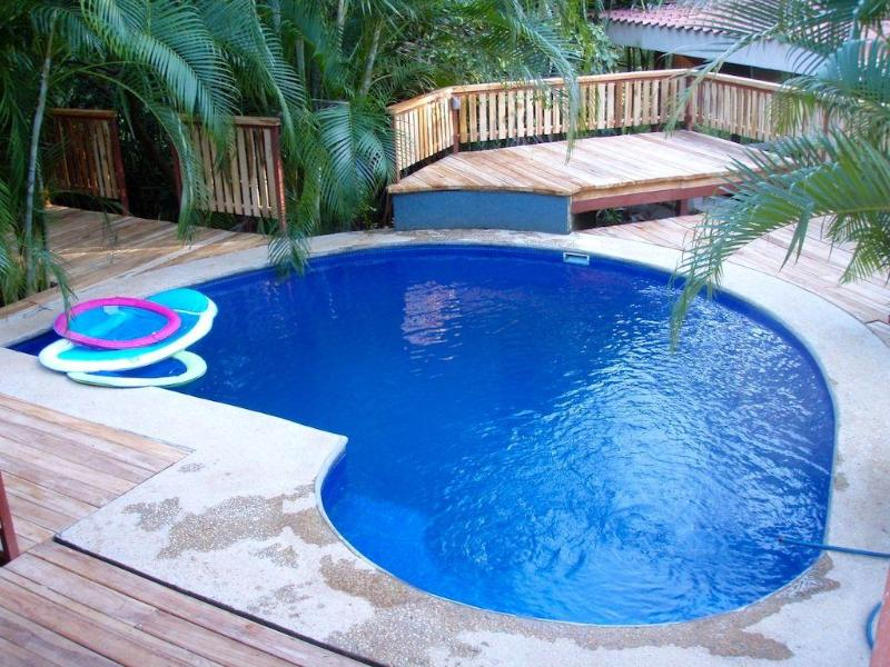 Teak decking around pool. - Harry's, El Escondite ~ Free Surfboards & Bikes! - Tamarindo - rentals