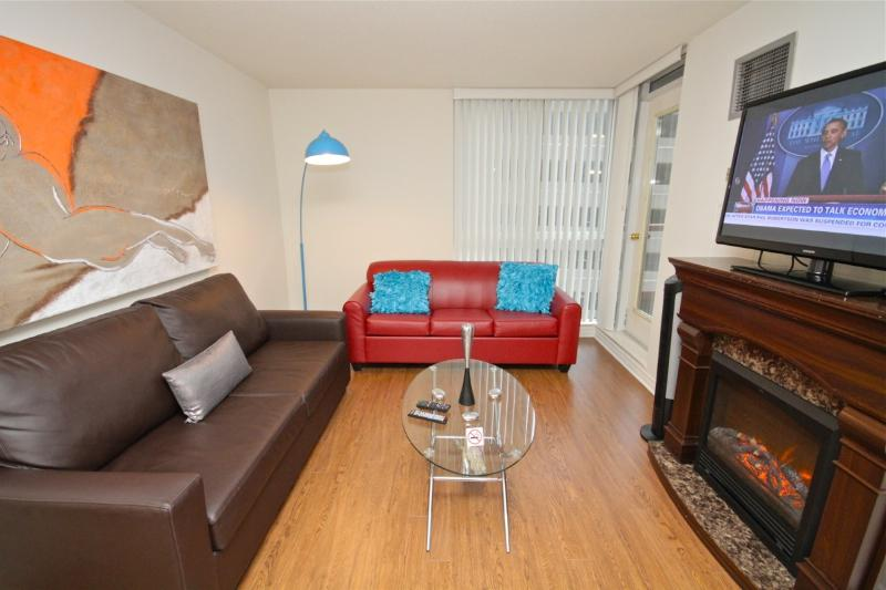 The Living Room with a fireplace, Plasma LCD TV and 2 double sofa beds - Downtown Toronto SHORT TERM CONDO 2 Bedroom 2 Bath - Toronto - rentals