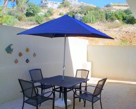 Patio fully furnished with distant sea view - Well located close to amenities, pool, FREE WiFi - Peyia - rentals