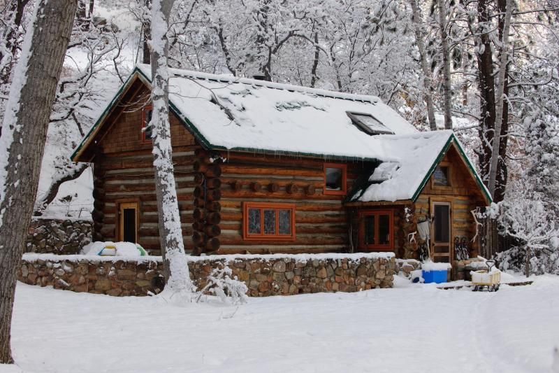 Winter at the cabin is magical with a cozy wood stove and plenty of wood provided - Pecos River Cabin: Experience winter's magic! - Pecos - rentals