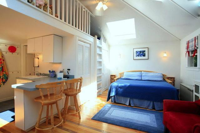 Bedroom and living area. - Sea Mist Cottage. Steps to shore, town, train - Rockport - rentals
