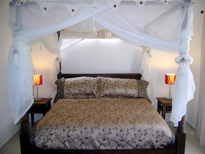 Teak Canopy Beds in each bedroom - 1 King & 1 Queen - Affordable Luxury Condo - Clean & Modern - Playa del Carmen - rentals
