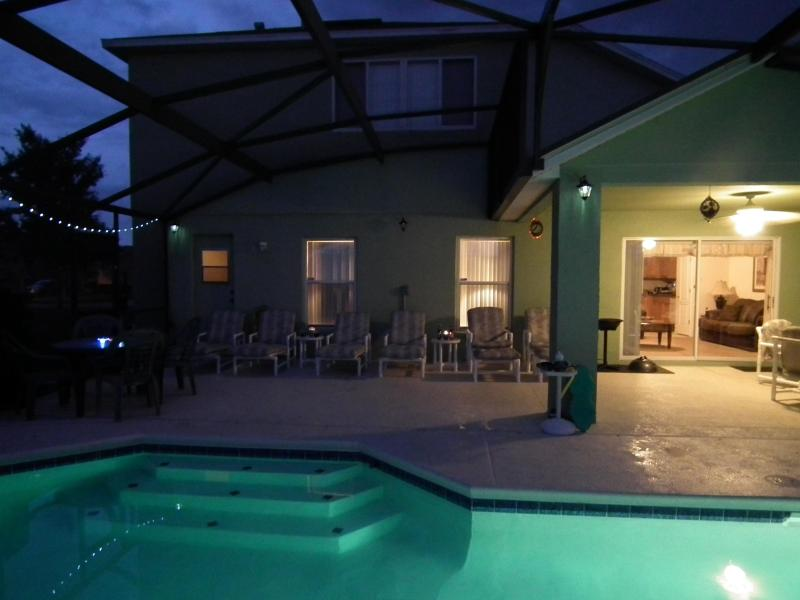 Extended Pool Deck partially covered with luxury cushioned loungers, recliners, chairs & tables - Dreamy Corner luxury family villa with lake views - Clermont - rentals