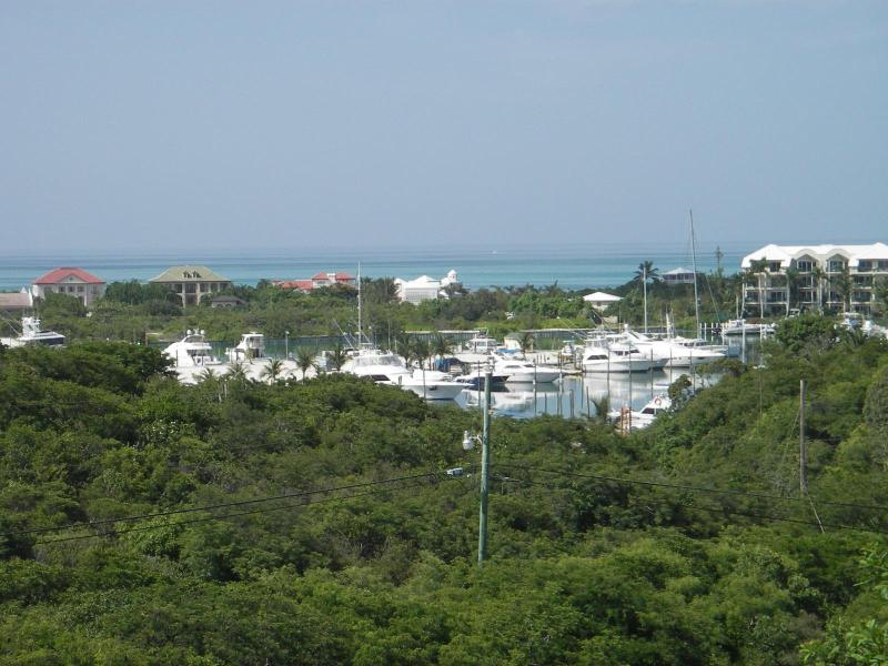 View of the ocean and Turtle Cove Marina from the deck. Pretty! - Million Dollar View - Affordable Cost - Providenciales - rentals