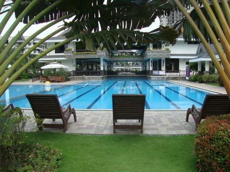 Loungers by the pool - Royal Palms Resort Two Bedroom w/Modern Appliances - Taguig City - rentals