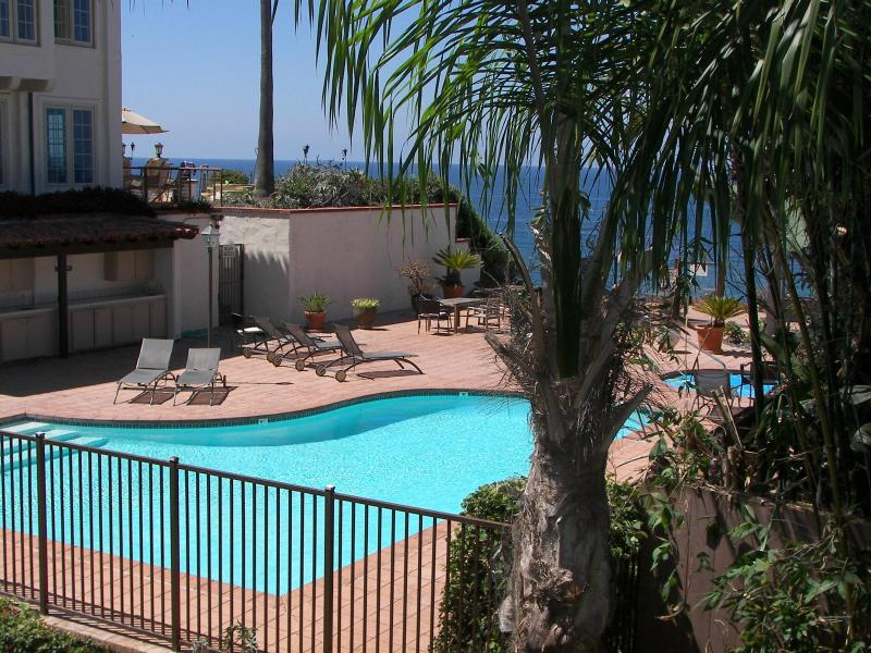 Deck Ocean View across pool and Jacuzzi deck - Beach Condo 122- Moonlight Beach, Pool, Spa, Beach - Encinitas - rentals