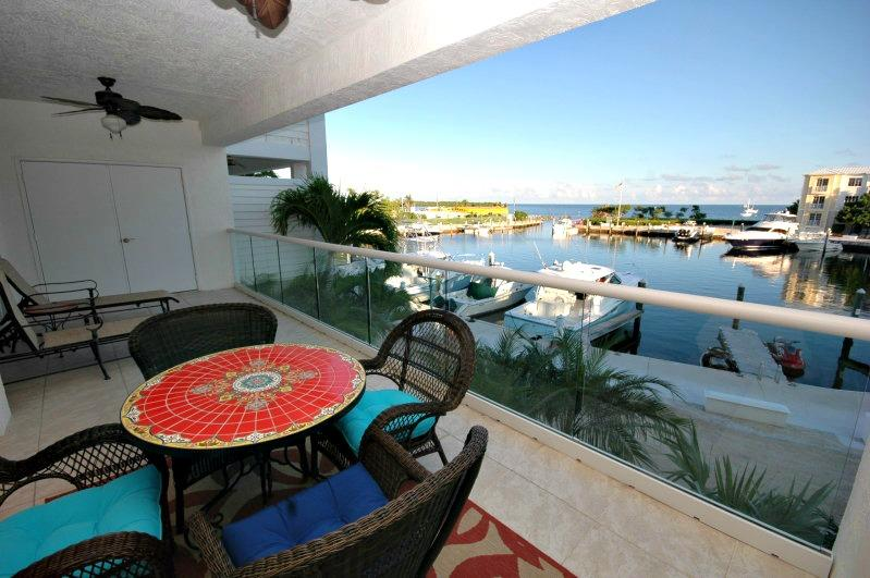 Patio with a view! - 3 bedroom luxury marina villa ~ 126 Mariners Club - Key Largo - rentals