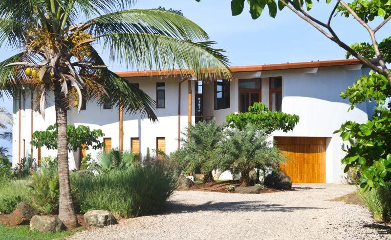 Tropical landscape and circular driveway with garage parking - Casa Ohana-Beach Front Surf Home-Stunning Views! - Playa Negra - rentals