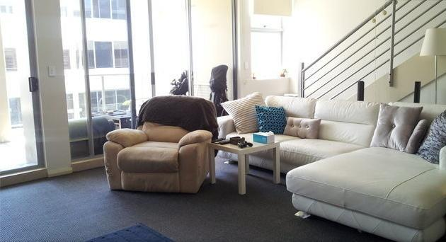 Other side of living room and balcony - Modern 2 bdrm aptmnt split lvl 15 mins to city - Mascot - rentals