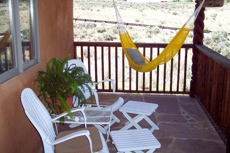 Read a book, take a nap, or just enjoy the view on the portal. - Casita Perdido - Taos - rentals